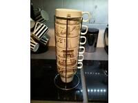 Set of six unused tea/coffee mugs on its stand /ifel tower theme