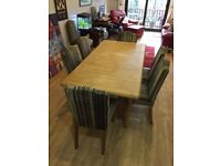 Wooden (oak)extending table with 8 beautiful covered chairs . Sell after March 11