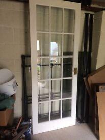 Fully glazed white painted door