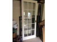 Fully glazed white painted door