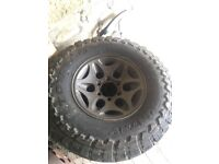 Set of L200 alloys with off road tyres