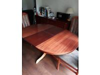 Round extendable dining table and 4 chairs