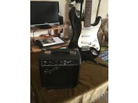 Stratocaster Guitar + stand + Squire 10watt amp