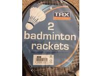 2 badminton rackets unused with stuttlecocks and carrier.