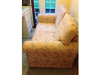 Lovely sofa bed with matching stool