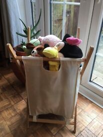 Linen basket full of mixed cuddly toys