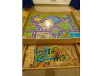 Wooden train table with 100 pieces and storage drawer