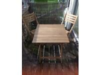 Outdoor table with two chairs