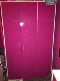 Pink triple wardrobe and set of drawers