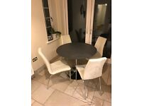 Granite top round kitchen table, with 4 white faux leather chairs