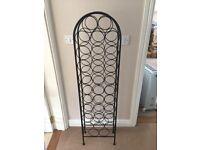 Black cast iron wine rack