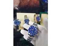 New and boxed silver bracelet and case blue bezel and face Rolex submariner watch automatic sweep