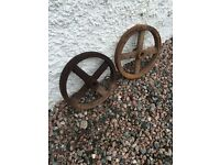 Pair of vintage metal wheels.