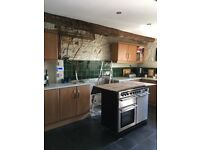 Kitchen units in good condition. Wall and base units in light oak veneer.