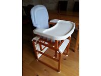High Chair That Converts to a Normal Height Chair and Table. Excellent condition.