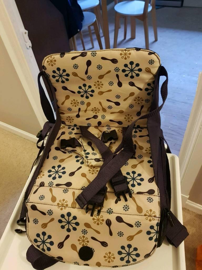 Munchkin portable booster seat