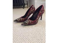 Never worn red, gold and black heels