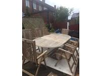 Bramblecrest teak 8 seater table and reclining carver chairs
