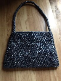 Beaded evening bag. Grey in colour. Used only once. Roughly the size of A5 envelope.