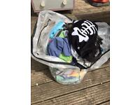 Bag full of boys clothes and shoes