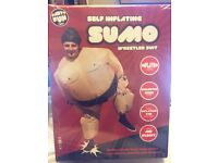 2 Self inflating sumo wrestler suits
