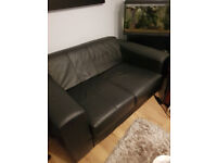 Black leather 2 seater sofa excellent condition hardly used x 2