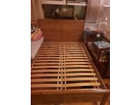 double bed frame with 2 night tables