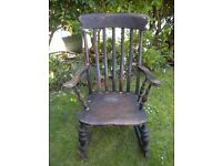 OLD HEAVY OAK ROCKING CHAIR NEEDS TLC AND REGLUEING BUT IT IS WONDERFUL