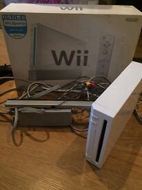 Nintendo Wii console with 6 controllers 2 nunchucks 1 steering wheel 3 protector covers