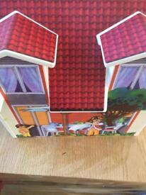 Play along doll house