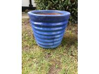 Small ceramic flower pot in a beautiful blue, with ridge detailing