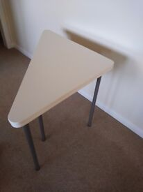 White square space saving table, seats 4. Folds to triangle to store in corner of room.