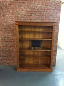 This is a beautiful solid pine book case with 4 movable shelves
