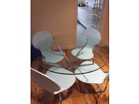 Circular glass kitchen/dining table and four chairs