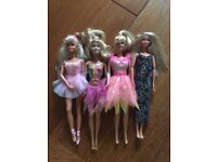 3 Barbie dolls and 1 other good condition