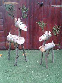 Handmade rustic log reindeers.