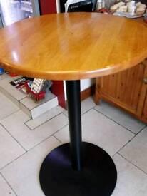A pair of soild pine tables