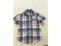 Boys short sleeved plaid button up shirt - Carters size 5 yr