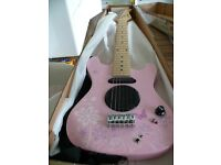 Junior Electric Guitar in Pink. Very good condition. £12
