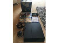 Play station 4 in good condition with 5 games and turtlebeach 400 gaming headphones