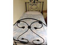 Beautiful wrought iron single bed with new Ikea mattress