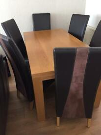Oak dinning table and 6 leather chairs