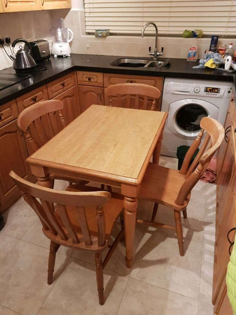 country style wooden kitchen table with 4 oak chairs  in