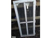 Old wooden window frame with glass one only
