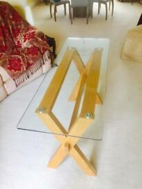 Glass table with wooden stand