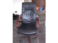 Very smart black leather swivel chair with wooden arm rests