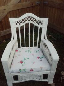 Shabby chic white cane chair with vintage style cushions