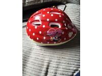 Girls Minnie Mouse cycle helmet.