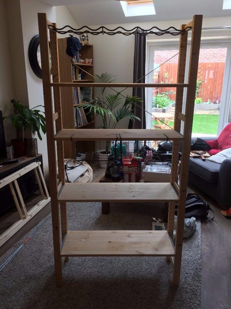 Ikea IVAR shelving system with wine racks and baskets. Book case, shelves.