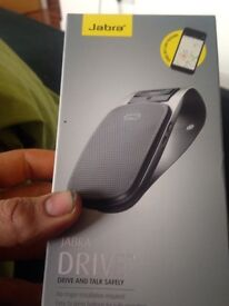 Brand new unopened Jabra drive along with in car phone stand